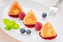 Fried camembert cheese with raspberry coulis and fresh berry Royalty Free Stock Photos