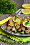 Fried capelin with lemon and herbs. Stock Images