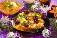 Fried carp with almonds and prune for christmas Stock Photos