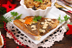Fried carp with almonds and sauerkraut for christmas eve Stock Image