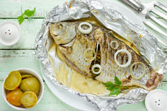 Fried carp with onion and herbs Royalty Free Stock Photography