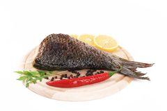 Fried carp on wooden platter. Stock Image