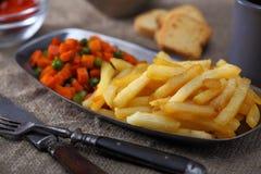 Fried carrot, potato and peas Royalty Free Stock Photos
