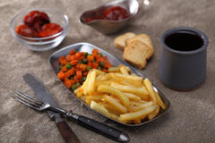 Fried carrot, potato and peas with wine Royalty Free Stock Images