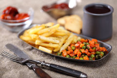 Fried carrot, potato and peas with wine Stock Photography