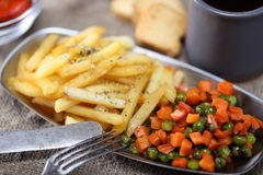 Fried carrot, potato and peas with wine Stock Photos