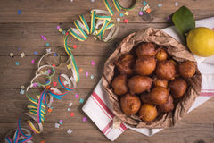 Fried castagnole carnevale. Fried carnival italian dessert in carnival top view composition Stock Photo