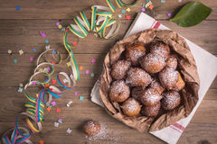 Fried castagnole carnevale. Fried carnival italian dessert in carnival top view composition Stock Image