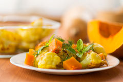 Fried cauliflower with a pumpkin Stock Photos
