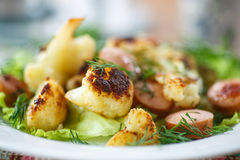 Fried cauliflower with sausages Royalty Free Stock Images