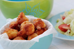 Fried cauliflower served with fresh salad. Fried cauliflower in blue bowl served with fresh vegetable salad Stock Photos