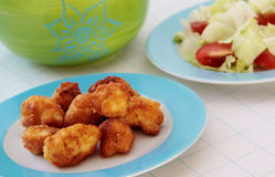 Fried cauliflower served with fresh vegetable salad. Fried cauliflower on blue plate served with fresh lettuce salad and tomatoes Royalty Free Stock Photo