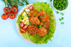 Fried caviar of river fish with lettuce leaves, cherry tomatoes on a light background. A dietary dish. Healthy eating Stock Photos