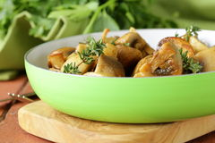 Fried champignon mushrooms with thyme Royalty Free Stock Images