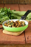 Fried champignon mushrooms with thyme Royalty Free Stock Image
