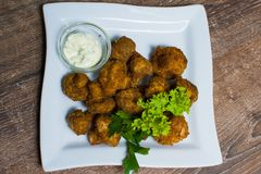 Fried champignons with sauce stock photo