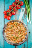 Fried chanterelle mushrooms with green onions in a frying pan Royalty Free Stock Photo