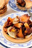 Fried chanterelle mushrooms with onion Royalty Free Stock Images