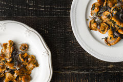 Fried Chanterelles In The Ceramic Plates On The Old Wooden Table Top View Royalty Free Stock Image