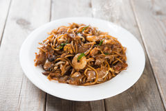Fried Char Kuey Teow. Popular noodle dish in Malaysia and Singapore royalty free stock image