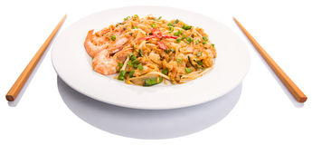 Fried Char Kway Teow III. A plate of gravy and fried char kway teow with prawns stock photography