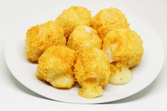 Fried Cheese Balls - cheese breaded and deep fried on white dish. royalty free stock photography