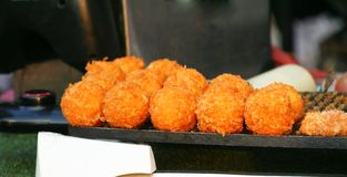 Fried cheese balls at street market royalty free stock photography