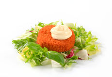 Fried cheese or fish with green salad Royalty Free Stock Photos