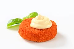 Fried cheese or fish with mayonnaise Stock Images