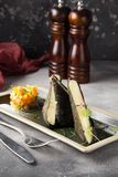 Fried cheese in nori leaves and breadcrumbs with vegetable tartare. Delicious food with beautiful presentation for restaurant menu stock photo
