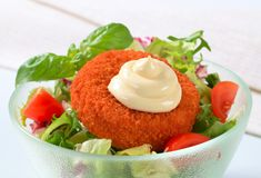 Fried cheese with vegetable salad and mayonnaise Royalty Free Stock Images