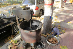 Fried chestnut automatic machine in winter Stock Photos