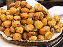 Fried chestnut. Wooden ware with hot fried chestnuts Stock Photography