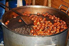 Fried chestnuts and fire Royalty Free Stock Photos