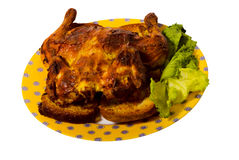 Fried chicken. Roast chicken on a yellow plate with green salad and an isolated background stock image