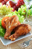 Fried chicken. With tomato on white dish Royalty Free Stock Images