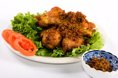 Fried chicken. On on a bed of lettuce and vegetables Stock Photo