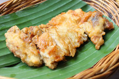 Fried chicken on a banana leaf Royalty Free Stock Photos