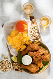 Fried chicken, beer and snacks to beer on white wooden surface. Fried chicken, beer and snacks to beer on a white wooden surface, top view royalty free stock images