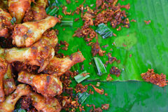 Fried chicken with black pepper. Fried chicken with black pepper paste on banana leaf Royalty Free Stock Photo