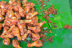 Fried chicken with black pepper. Fried chicken with black pepper paste on banana leaf Royalty Free Stock Image