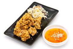 Fried chicken in black plate with sauce Royalty Free Stock Images