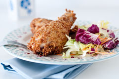 Fried chicken with breading of cornflakes and salad Stock Photos