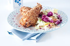 Fried chicken with breading of cornflakes and salad Royalty Free Stock Image