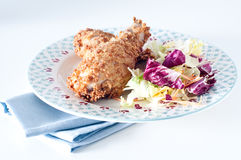 Fried chicken with breading of cornflakes and salad Stock Image