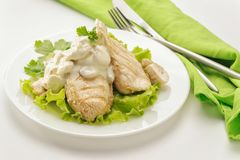 Fried chicken breast with cream sauce stock photo