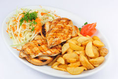Fried chicken breast with fries and salad Stock Photography