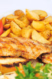 Fried chicken breast with fries and salad Stock Images