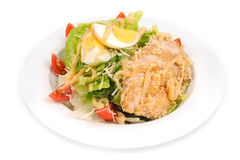 Fried chicken breast green salad royalty free stock image
