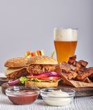 Fried chicken burgers beer royalty free stock photography